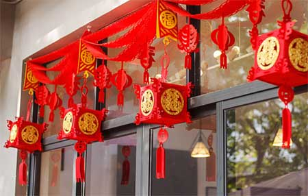 Red couplets are put up for Chinese New Year.