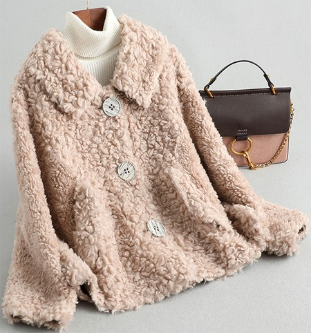 Women's winter warm fur coat made of natural wool